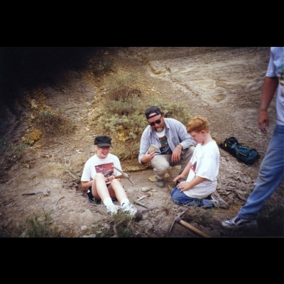 Ray and his son Patrick check out his daughter Corinna's mosasaur find in the fossil filled chalk beds of western Kansas in 1999.