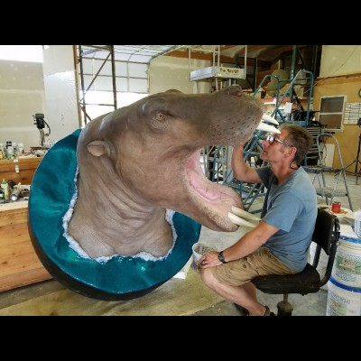 Gary working on a sculpture of the Alaskan Ounalashkastylus, a type of desmostylian for Ray's Cruisin' the Fossil Coastline exhibit.