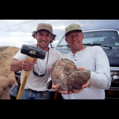 Gary Staab and his fossil hunting buddy Kent Hups show off their splendid ammonite find.