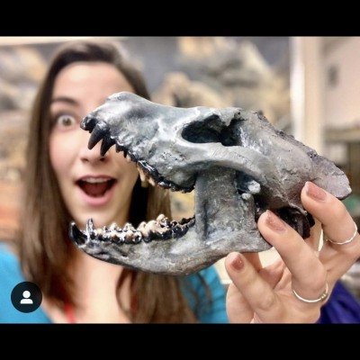 Amy and her favorite fossil, the bone-crushing Borophagine prehistoric dog called Paratomarctus.