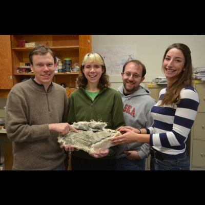 Amy as an undergraduate student at the University of Oregon. They're holding the fossil of a giant spike-toothed salmon.