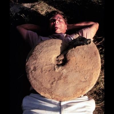 Kirk relaxing with a 30-pound ammonite on his belly at the Kremmling, Colorado dig site in 1998.
