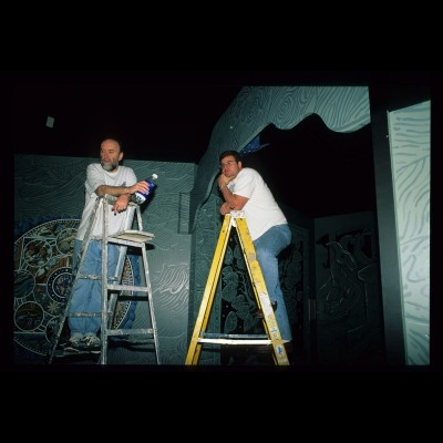 The artist and the scientist up on ladders figuring out their next move at the Denver Museum of Nature and Science in 1999.