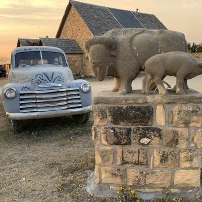 A limestone buffalo carving by Pete Felten greets visitors to the Keystone Gallery.