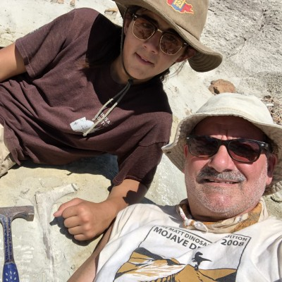 Luis with Juan Alvarez, a highschool student from Long Beach, posing with a T. rex bone in New Mexico.