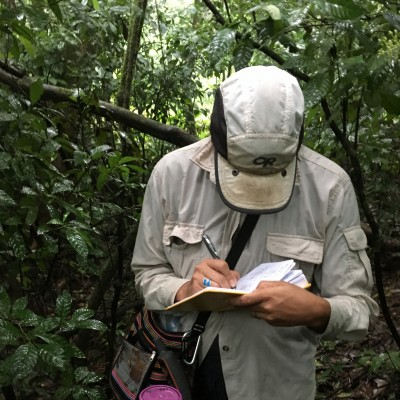 Taking notes from a study collecting modern soils in the Argentinan rain.